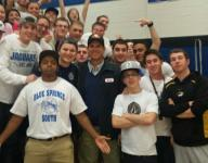 Harbaugh attends HS game