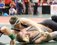 Heyob finishes perfect to make St. X history