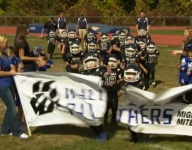 Remember the tykes who couldn't break a football banner? They got a second chance