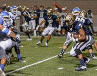 Panthers get stride in 2nd half, pull off 50-32 win over Mustangs