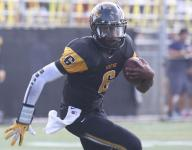 Why are firmly committed stars like QB Torrance Gibson still taking official visits?