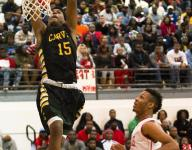 Carver hangs on to city crown