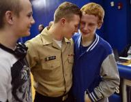 Military man surprises brothers at wrestling tournament