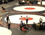 Time-lapse: the final mat is rolled up from the state wrestling tournament