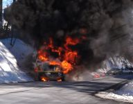 Bus carrying New Jersey hockey team catches fire