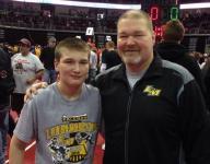 Wrestling coach makes quick return after stroke