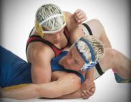 Four area wrestlers win at Conference 29