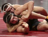 Hospitalized wrestler's condition improves