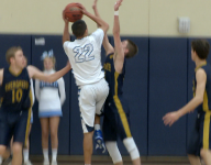 Valor dominates in overtime to beat Evergreen 64-54