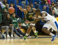 Crispus Attucks' Hutchison helping restore school's basketball legacy of greatness