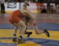 Russo hangs on for pre-quarterfinal win; 16 Region VI wrestlers advance