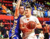 U-E boys race away from M-E for 'A' basketball title