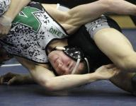 Mason wins first district wrestling team title