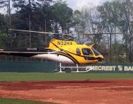 Baseball teams use helicopter to dry field in Georgia