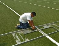 Washington soccer coach seeks link between artificial turf, cancer