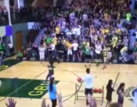 VIDEO: Illinois teacher somehow hits backwards, one-handed midcourt shot two straight years at pep rally