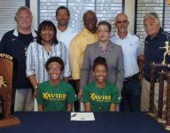 WCA track stars sign with Xavier