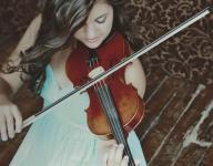 Valley Lutheran's Neuman masters school, 3 sports, violin