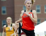 Johnson holds off strong field to win second 800 title