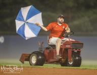 New photo of umbrella-clearing fog attempt by Little League Senior League umpires makes the groundskeeping trick even better