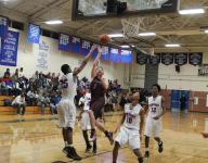 Photos: Robinson at North Meck boys and girls basketball