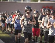 Hurricane Tigers fueled by state title loss, aim to finish the job in 2015