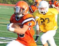 Anderson football mixes young and old