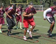 Aquinas football moves ahead after tough '14