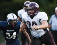 H.S. football roundup: Defending champ tested by MAU