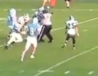 VIDEO: Wisconsin commit trucks over referee on powerful run in rival game