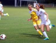 Lady Bison grind out district victory