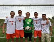 BOYS' SOCCER NOTEBOOK: Cherokee is determined