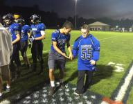 Teen honored at Brockport football game