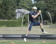 Freehold football hangs on to beat Middletown North