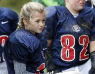 Girl breaks Catholic football league barrier