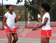 Dwyer sisters push through in conference quarterfinals