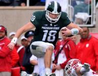 Cook stellar as MSU routs Indiana, 52-26