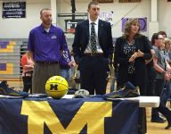 Michigan recruit Austin Davis celebrates signing day with small town
