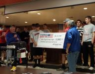 Lincoln football raises funds for Honor Flight