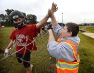 Hillcrest's ultimate fan rides his bike to every game