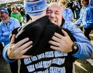 Lansing Catholic boys run to D3 cross country title