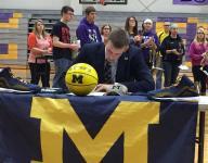 U-M recruit Davis celebrates signing day with town