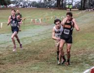 Plant City runner helps Plant competitor across finish
