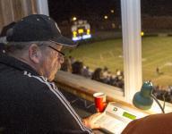 Press box volunteers keep the focus on the field