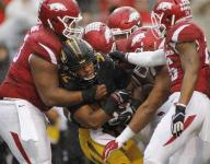 Arkansas topples Missouri, 28-3