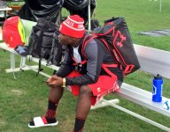 One of Miami's top recruits, Sam Bruce, is sporting Ohio State gear at Under Armour practice