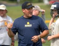Grundy stepping down after decade at West