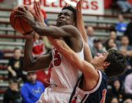 Holmes tops St. Henry for first win
