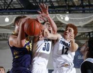 East Lansing boys hoops tops DeWitt in opener