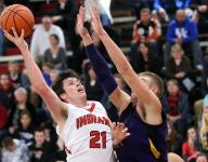 Hot shooting carries Holy Cross